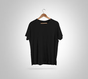 Blank black t-shirt front on hanger, design mockup, clipping path Stock Image