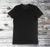 Blank black t-shirt on a wooden surface Stock Photography