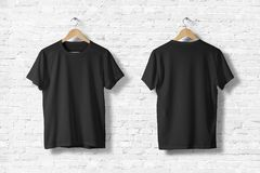Blank Black T-Shirts Mock-up hanging on white wall, front side view. Blank Black T-Shirts Mock-up hanging on white wall, front and rear side view. Ready to stock image