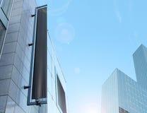 Blank black vertical banner on building facade, design mockup Stock Photography
