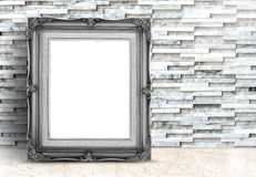Blank black Vintage frame on marble floor and white stone tiles Stock Images