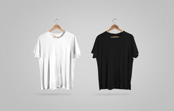 Blank black and white t-shirt on hanger, design mockup Royalty Free Stock Photos