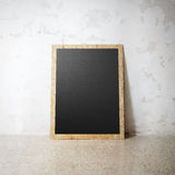 Blank black wooden natural frame on a cocrete wall Royalty Free Stock Photo