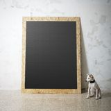 Blank black wooden natural frame and little dog Stock Photo