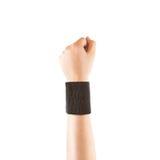 Blank black wristband mockup on hand, isolated