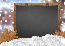 Blank blackboard with blurr city and snow and leaves Royalty Free Stock Images