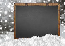 Blank blackboard with blurr forest and snow Stock Photo