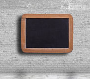 Blank blackboard on the brick wall Royalty Free Stock Image