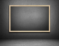 Blank blackboard on cement background Royalty Free Stock Photos