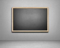 Blank blackboard on cement background Stock Photography