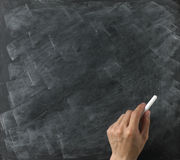 Blank blackboard chalk in hand Royalty Free Stock Image