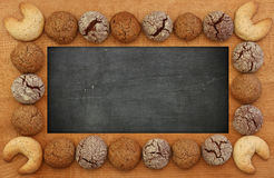 Blank Blackboard, Chalkboard, wooden frame and cookies, copy spa Royalty Free Stock Photography