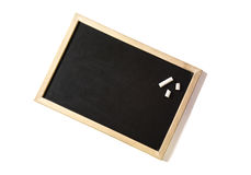 Blank blackboard with chalks. Stock Photo