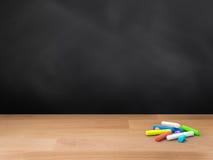 Blank blackboard with chalks Stock Photos