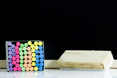 Blank blackboard. And colored Chalk with  eraser Royalty Free Stock Image