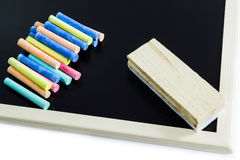 Blank blackboard. And colored Chalk with  eraser Royalty Free Stock Photo