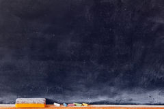 Blank blackboard with colored chalks Stock Photo