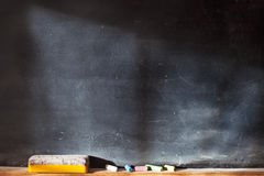 Blank blackboard with colored chalks Royalty Free Stock Photo