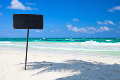 Blank blackboard display on tropical beach Royalty Free Stock Photo