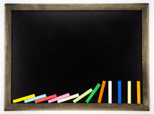Blank blackboard with domino colorful chalks Royalty Free Stock Images