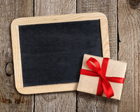 Blank blackboard and gift box Stock Photo