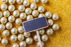 Blank blackboard label and golden balls royalty free stock photo
