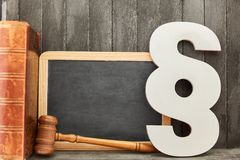 Blackboard and law concept with paragraph and judge gavel. Blank blackboard and law and law concept by paragraph and judge gavel stock photos