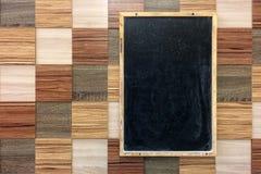 Blank blackboard on a motley wall. Template mock up royalty free stock photo