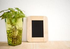 Blank Blackboard Photo Frame on Wooden for Design Mockup Stock Photos