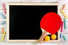 Blank blackboard, Ping pong ball on wooden table.Template mock u Royalty Free Stock Photo