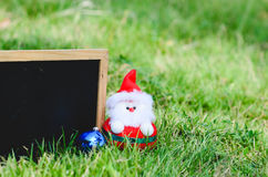 Blank blackboard with Santa doll. Stock Photo
