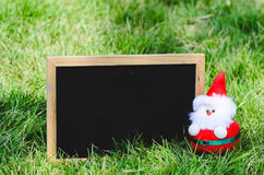 Blank blackboard with Santa doll. Royalty Free Stock Image