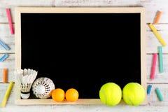 Blank blackboard, Shuttlecock, Ping pong ball and Tennis ball on Stock Image