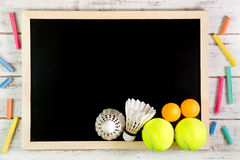 Blank blackboard, Shuttlecock, Ping pong ball and Tennis ball on Stock Images