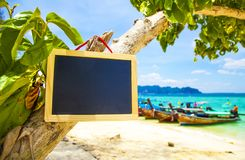 Blank blackboard sign on tropical beach royalty free stock photography