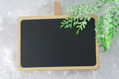 Blank blackboard on snow Royalty Free Stock Images