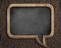 Blank blackboard on soil for sowing advice Royalty Free Stock Images