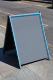 Blank blackboard in a sunny street Stock Images