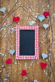 A blank blackboard surrounded by wooden hearts Stock Images