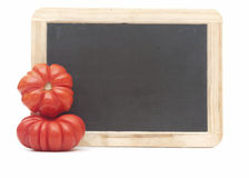 Blank blackboard with two ripe tomatoes Royalty Free Stock Photo