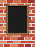 Blank blackboard on wall Stock Photo