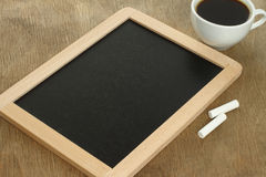 Blank blackboard with white chalks and coffee Royalty Free Stock Images