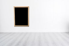 Blank blackboard on White wall with wooden gray floor and copysp Stock Photography