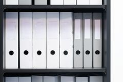 Blank blind folders with files in the shelf. Archival, stacks of documents in the book at the office with space for text royalty free stock photo