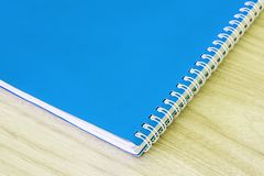 Blank blue book empty cover book spiral stationery school supplies for education business idea book cover design note pad memo on stock photo