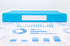 Blank blue folder with analytic graph and business reports. Blank label of blue document file with chart, analytic graph and business reports royalty free stock photography