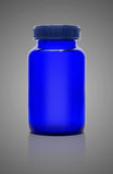 Blank blue glass bottle of supplement product isolated on gray Stock Images
