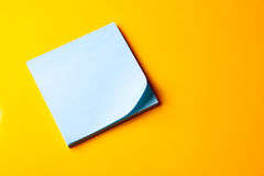 Blank blue note on orange background Royalty Free Stock Photos