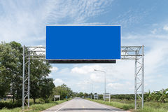 Blank Blue Road Sign. Pair of roadsigns in blue color on road and sky royalty free stock photography