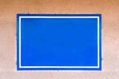 Blank Blue Sign on an Adobe Wall Stock Photography
